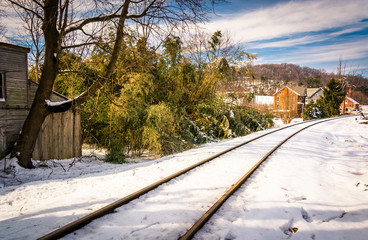 Snow covered railroad tracks in Lineboro, Maryland.