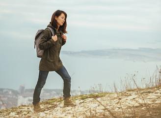 Hiker woman trekking in highlands