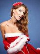 Beautiful  woman in Santa Claus clothes with gift