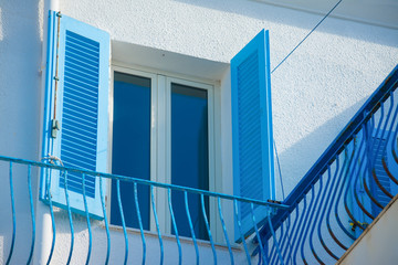 blue window and railing