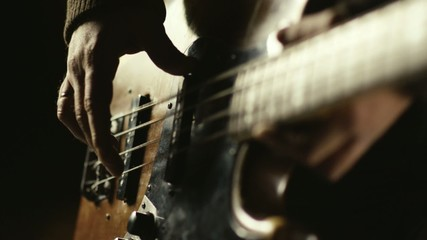 Man playing bass guitar in slowmotion