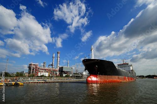 A ship in refinery port - 74847815