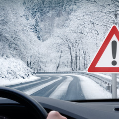 Winter Driving - Caution - Curvy Snowy Country Road