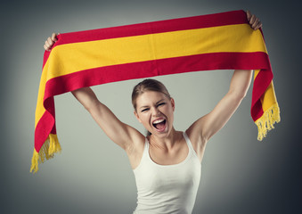Woman football fan cheering with flag celebrating victory