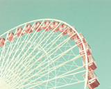 Vintage pastel ferris wheel over turquoise sky