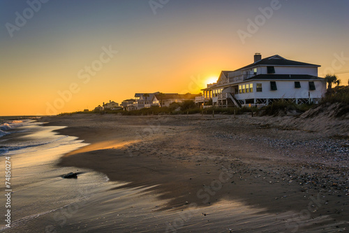 Sunset over beachfront homes at Edisto Beach, South Carolina.