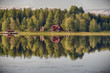 Summer in Sweden - traditional red Cottage at a lake  - 74850815
