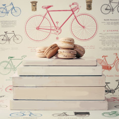 Macaroons over vintage books with bicycle background
