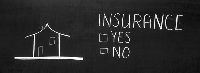 Insurance written on the blackboard with chalk