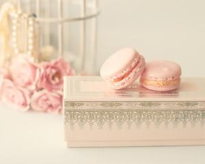 Pink macaroons over an elegant box