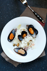 Italian mussels with rice in white plate