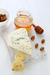 Blue cheese with almonds, figs and honey