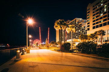 The boardwalk at night in Daytona Beach, Florida.