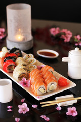 Sushi with candles and flowers