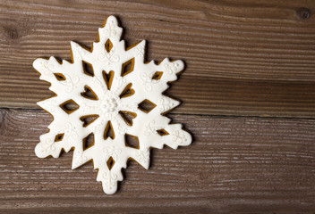 Gingerbread star on wooden background