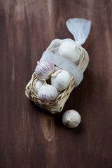 Chinese garlic in a traditional wicker tray, high angle view