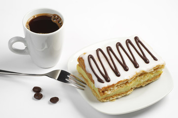 Coffee and creamy cake with chocolate