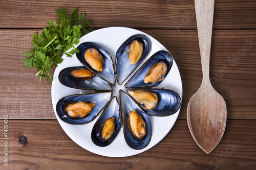 prepared mussels on wooden background - 74854882