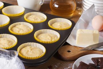 Preparation of vanilla muffins close-up  horizontal