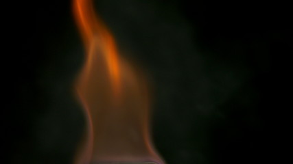 Fire burning at night rising in 3840X2160 4K UHD video.