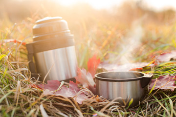 Vacuum flask and cup