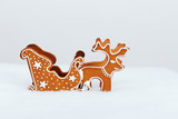 The hand-made eatable reindeer and cart with snow decoration poster