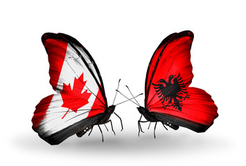 Two butterflies with flags Canada and Albania