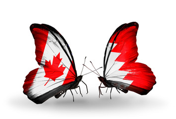 Two butterflies with flags Canada and Bahrain