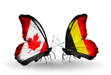 Two butterflies with flags Canada and Belgium