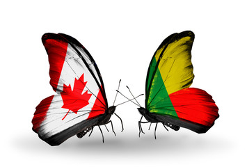 Two butterflies with flags Canada and Benin