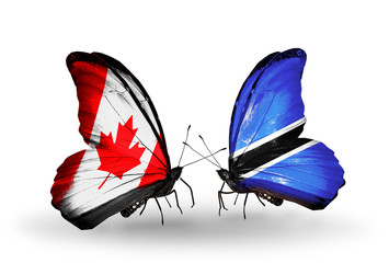Two butterflies with flags Canada and Botswana