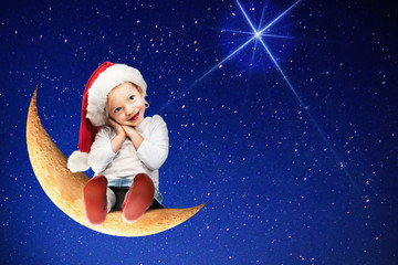 Little girl with santa hat sitting on the moon