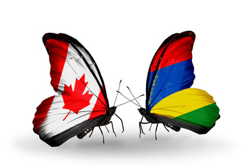 Two butterflies with flags Canada and Mauritius