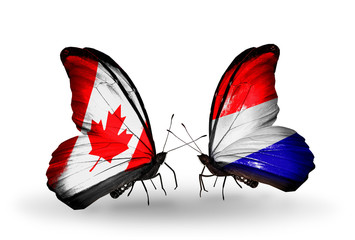 Two butterflies with flags Canada and Holland