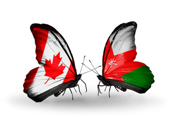 Two butterflies with flags Canada and Oman