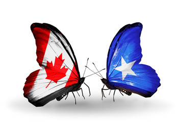 Two butterflies with flags Canada and Somalia
