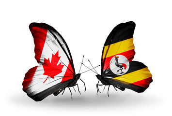 Two butterflies with flags Canada and Uganda