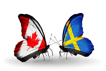 Two butterflies with flags Canada and Sweden