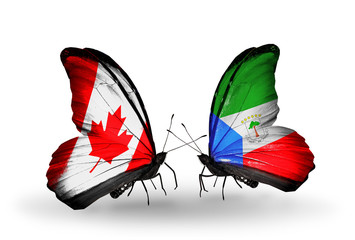 Two butterflies with flags Canada and Equatorial Guinea