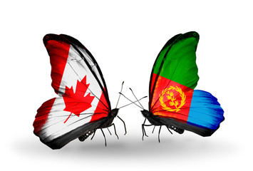 Two butterflies with flags Canada and Eritrea