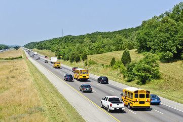 School Buses And Other Traffic On Interstate Highway