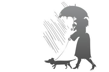 Passeggiare sotto l'ombrello con il cane