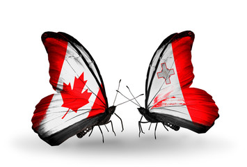 Two butterflies with flags Canada and Malta