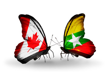 Two butterflies with flags Canada and Myanmar