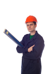 man in helmet and  blue robe holding building level