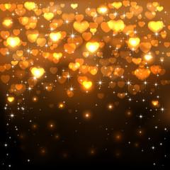 Golden hearts on dark background