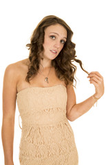 woman tan strapless dress play with hair