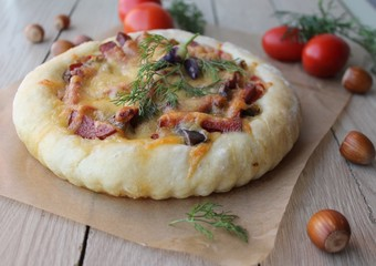 pizza with eggplant and sausage and nuts