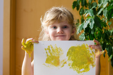 girl with printed hands on paper