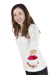 Valentines day woman showing coffee cup filled with hearts